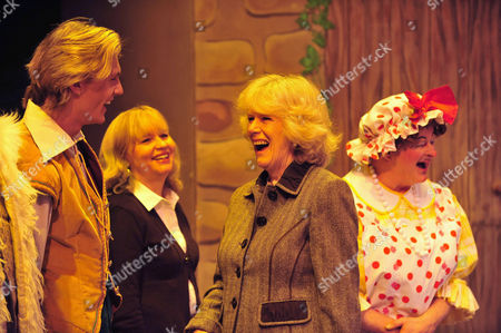 Camilla, Duchess of Cornwall speaks with the runner-up on the BBC's Any Dream Will Do competition Lewis Bradley (blonde hair) and cast members from the pantomime Jack and the Beanstalk
