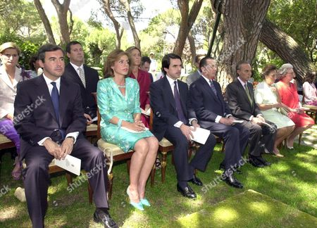 Md15 - 20020623 - Madrid Spain : Spanish Prime Minister and Current Eu President Jose Maria Aznar (3rdl) His Wife Ana Botella (2ndl) Spanish Justice Minister Angel Acebes (l) the Duke (3rdr) and Duchess (2ndr) of Soria Spanish Infanta Pilar (r) and the Duke of Calabria (4thr) Attend the Catholic Baptism Ceremony of the Spanish Royal Couple's Fifth Grandson Miguel Urdangarin De Borbon at the Spanish Royal Family's Official Residency La Zarzuela Palace Outside Madrid Sunday 23 June 2002 Epa Photo Efe / Manuel H De Leon / Gb Bp Fob Spain Madrid
