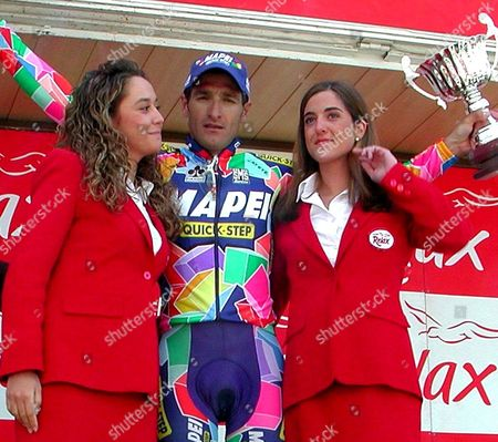 Stock Photo of Ter02 -20020420- Teruel Spain: Italian Rider Davide Bramati of the Team Mapei-quick Step with the Trophy After Winning the Fourth Stage of the Aragon Cycling Tour in Teruel North of Spain on Saturday 20 April 2002 Italian Leonardo Piepoli of the Team Ibanesto Com Continues As Overall Leader of the Race Epa Photo Efe/francisco Montero Spain Teruel
