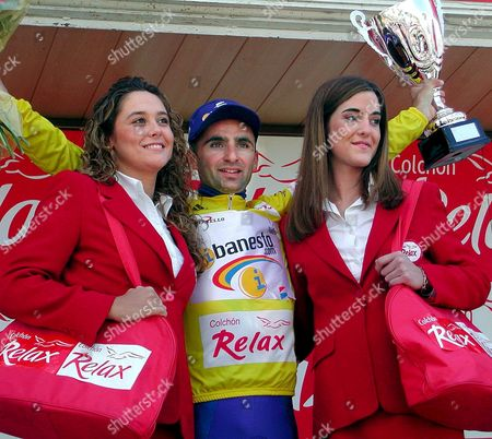 Stock Image of Ter03 - 20020420 - Teruel Aragon Spain :italian Rider Leonardo Piepoli of the Team Ibanesto Com with the Trophy As Overall Leader of the Aragon Cycling Tour in Teruel North Spain on Saturday 20 April 2002 Italian Davide Bramati of Mapei-quick Step Team Won the Fourth Stage Epa Photo Efe/francisco Montero Spain Teruel