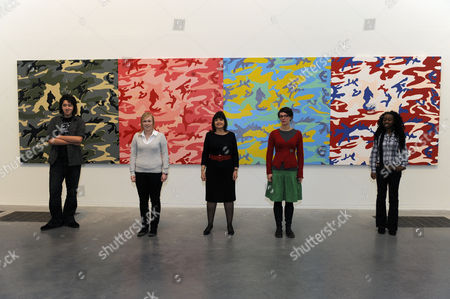 Barbara Follett (Minister for Culture, Creative Industries and Tourism) and students standing next to an Andy Warhol painting