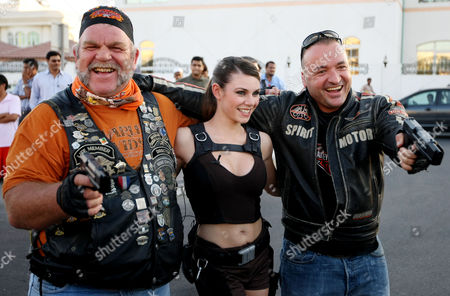 The Official 2008 Lara Croft, AKA Alison Carroll from Croydon, with 2 Members of the Harley Owners Group