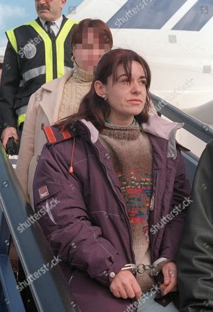 Md-20 20011210- Madrid Spain: Suspected Eta Member Monica Martinez Lopez Arrives at the Barajas Airport on Monday 10 December in Madrid After Being Extradited by France to Spain Monica Martinez Lopez is Charged For Giving Information to Eta Vizcaya Command and Taking Part in Numerous Attacks As a Supposed Member of a Eta Support Group Epa Photo Efe/dgp Spain Madrid