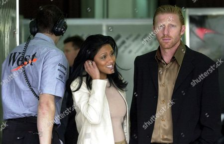 V16 - 20010207 - Valencia Spain : German Tennis Legend Boris Becker (r) is Flanked by His New Girlfriend German Rap Singer Sabrina Setlur (c) in the Box of the West Mclaren Mercedes Team Wednesday 07 February 2001 During the Official Presentation of the New Mclaren Mercedes Formula One Car Epa Photo Efe/alberto Estevez/ae/bp-hh Spain Valencia