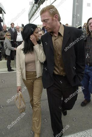 V17 - 20010207 - Valencia Spain : German Tennis Legend Boris Becker (r) is Flanked by His New Girlfriend German Rap Singer Sabrina Setlur (l) Wednesday 07 February 2001 During the Official Presentation of the New Mclaren Mercedes Racing Car in Valencia Epa Photo Efe/alberto Estevez/ae/bp-hh Spain Valencia
