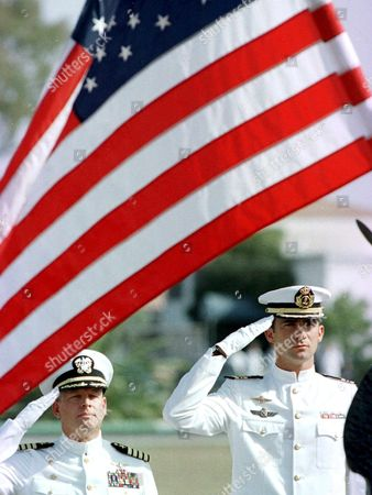 Jer01 - 20010916 - Rota Andalucia Spain : Spanish Prince Felipe (r) is Flanked by Us Navy Major Richard Noble (l) As Both Salute the American Flag During a Commemoration Ceremony For Those who Died in the Terrorist Attacks in New York and Washington Last Tuesday Sunday 16 September 2001 at the Navy Base of Rota Cadiz Used by Both American and Spanish Forces Epa Photo Efe/jaro Munoz/jm/ep/mda Spain Rota
