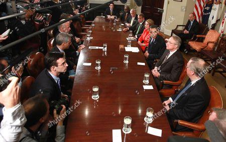 (L-R-Right table) Rep. James E. Clyburn (D-SC), House Majority Leader Steny Hoyer (D-MD), House Minority Leader John Boehner (R-OH), Speaker of the House Nancy Pelosi (D-CA), Senate Majority leader Harry Reid (D-NV) (R), (2nd-L-Left table) White House Chief of Staff Rahm Emanuel, (3rd-L-Left table) and Vice President Joe Biden listen as U.S. President Barack Obama (2nd-R) speaks