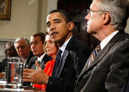 (L-R) Rep. James E. Clyburn (D-SC), House Majority Leader Steny Hoyer (D-MD), House Minority Leader John Boehner (R-OH), Speaker of the House Nancy Pelosi (D-CA) and Senate Majority leader Harry Reid (D-NV) (R) listen as U.S. President Barack Obama (2nd-R) speaks
