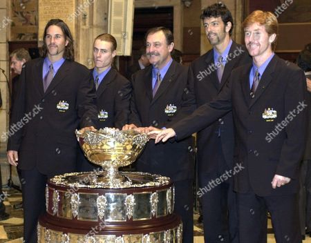 B09 - 20001207 - Barcelona Spain : Australian Davis Cup Team Captain John Newcombe (centre) is Flanked by His Players During the Draw Ceremony in Barcelona on Thursday 07 December 2000 From Left - Patrik Rafter Lleyton Hewitt Captain John Newcombe Sandon Stolle and Mark Woodforde Pose with the Davis Cup Trophy Australia Will Face Spain in the Davis Cup Final Starting on Friday December 08 Epa Photo Efe/lluis Gene Spain Barcelona