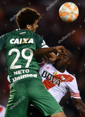 River Plate's Eder Alvarez Balanta (r) Vies For the Ball with Chapecoense's Neto (l) During Their Copa Sudamericana Soccer Match at Antonio Vespucio Liberti Stadium in Buenos Aires Argentina 21 October 2015 Argentina Buenos Aires