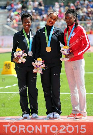 (l-r) Tenaya Jones (silver) Queen Harrison (gold) Both From the United States and Nikkita Holder From Canada (bronce) Pose with Their Medals in 100 Meters Hurdles During the Pan American Games 2015 in Toronto Canada 22 July 2015 Canada Toronto