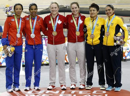 (l-r) Lisandra Guerra and Mariles Mejias From Cuba (silver Medal) Kate O'brian and Monique Sullivan From Canada (gold); and Diana Garcia and Juliana Gaviria From Colombia (bronze) Pose with Their Medals in the Women's Team Sprint at the Pan American Games 2015 in Toronto Canada 16 July 2015 Canada Toronto