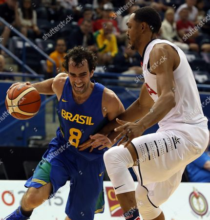 Brazilian Basketball Player Vitor Benite (l) Psuhes Past Usa's Ryan Hollins (r) During the Match Between the Us and Brazil at the Pan Am Games 2015 in Toronto Canada 23 July 2015 Canada Toronto