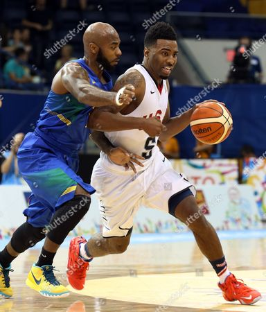 Usa's Keith Langford (r) Dribbles Past Brazilian Player Larry Taylor During the Basketball Match Between the Us and Brazil at the Pan Am Games 2015 in Toronto Canada 23 July 2015 Canada Toronto