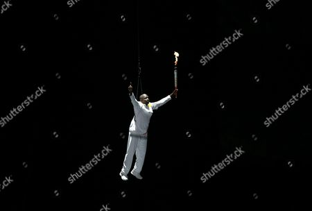 Two-time Olympic Gold Medallist Donovan Bailey Descends with the Pan American Games Torch During the Inauguration Ceremony of the Pan American Games at the Rogers Center in Toronto Canada 10 July 2015 Canada Toronto