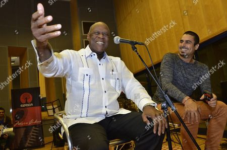 Dominican Musician Johnny Ventura (l Gives a Press Conference Next to Cuban Singer Elain Morales (r) where Ventura Spoke About His Activities During His Visit to Cuba Anecdotes About His Professional Life and Sung Several Songs Before Two Concerts Next 10 and 11 July Havana Cuba on 7 July 2015 Cuba La Habana