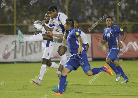 Stock Picture of Miguel Pena (r) From El Salvador National Soccer Team Fights For the Ball with Darry Lachman (l) From Curazao During the Second Leg Match For Qualifier Round to Russia 2018 at Cuscatlan Stadium in San Salvador El Salvador 08 September 2015 Curazao is Coached by Former Dutch International Patrick Kluivert El Salvador San Salvador