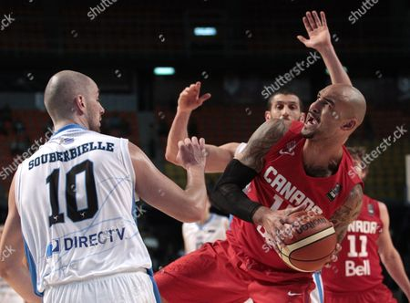 Stock Picture of Canada's Robert Sacre (r) Against Uruguay's Marcel Souberbielle (l) During a Match of the Fiba Americas Tournament a Qualifier For the Olympic Games in Rio De Janeiro 2016 at Palacio De Los Deportes in Mexico City Mexico 07 September 2015 Mexico Mexico City