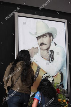 A Woman Looks at an Image of Late Mexican Popular Singer Joan Sebastian on His Last Goodbye Along with Relatives in Mexico City Mexico 16 July 2015 Joan Sebastian Died of Cancer at the Age of 64 Mexico Mexico City