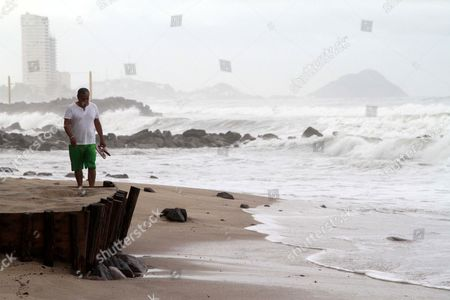 A Man Walks at a Beach in Front of Strong Waves Due to Hurricane Linda in Mazatlan Mexico 08 September 2015 Hurricane Linda Rapidly Strengthened For the Second Time in Its Existence on 08 September Morning Maximum Sustained Winds Increased From 90 Mph at 5 a M Edt to 120 Mph at 11 a M Edt This Makes Linda a Category 3 Hurricane on the Saffir-simpson Hurricane Wind Scale Mexico Mazatlan