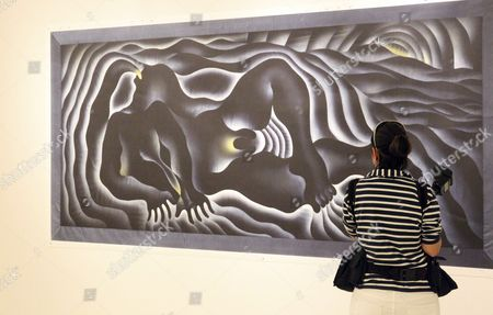 Stock Photo of A Visitor Looks at One of the Artworks by Us Feminist Artist Judy Chicago Included in the Exhibition 'Why not Judy Chicago' at the Azkuna Zentroa Arts Center in Bilbao in the Region of the Basque Country Northern Spain 07 October 2015 the Event Runs From 08 October 2015 to 10 January 2016 Spain Bilbao