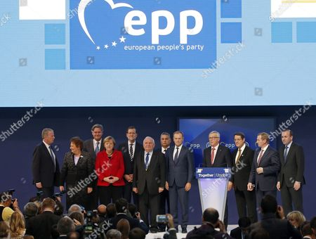 German Chancellor Angela Merkel (4l) Austrian Vice Chancellor Reinhold Mitterlehner (2l) Latvian Prime Minister Laimdota Straujuma (2l) Spanish Primer Minister Mariano Rajoy (5l) European Popular Party President Joseph Daul (6l) European Couincil's President Donald Tusk (5r) and European Comission President Jean Claude Juncker (4r) Cyprus' President Nicos Anastasiades (3r) and Irish Prime Minister Enda Kenny (2r) Among Others Pose During the Family Picture During the Second Day of the European People's Party (epp) Congress Held in Madrid Spain on 22 October 2015 Spain Madrid