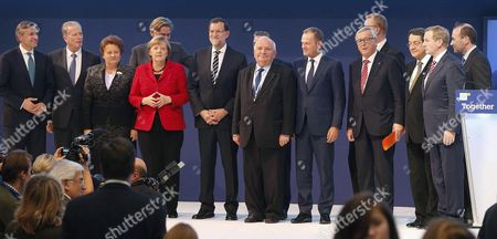 German Chancellor Angela Merkel (4l) Austrian Vice Chancellor Reinhold Mitterlehner (2l) Latvian Prime Minister Laimdota Straujuma (3l) Spanish Primer Minister Mariano Rajoy (5l) European Popular Party President Joseph Daul (c) European Couincil's President Donald Tusk (5r) and European Comission President Jean Claude Juncker (4r) Cyprus' President Nicos Anastasiades (3r) and Irish Prime Minister Enda Kenny (r) Among Others Pose During the Family Picture During the Second Day of the European People's Party (epp) Congress Held in Madrid Spain on 22 October 2015 Spain Madrid