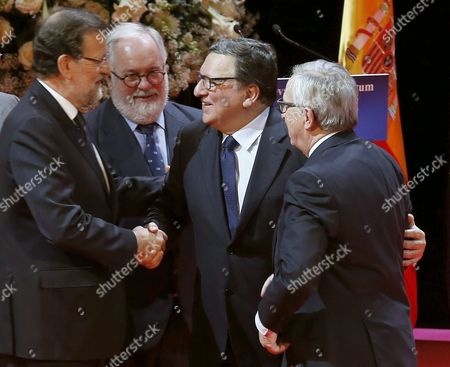 Stock Image of Spanish Prime Minister Mariano Rajoy (l) Shakes Hands with Former President of the European Commission Jose Manuel Durao Barroso (2-r) Next to the President of the Eu Commission Jean Claude Juncker (r) and the Eu Commissioner of Climate and Energy Miguel Arias Canete During the New Economy Forum Award Ceremony Held at the Zarzuela Theatre in Madrid Spain 21 October 2015 Juncker was Awarded with the New Economy Forum Prize 2015 During the Event Spain Madrid