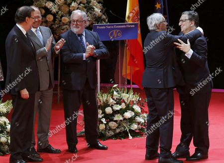 President of the Eu Commission Jean Claude Juncker (2-r) Greets His Predecessor Jose Manuel Durao Barroso (r) in Presence of Spanish Prime Minister Mariano Rajoy (l) the Eu Commissioner of Climate and Energy Miguel Arias Canete (3-l) and the Speaker of Lower Chamber of Spanish Parliament Jesus Posada (l) During the New Economy Forum Award Ceremony Held at the Zarzuela Theatre in Madrid Spain 21 October 2015 Juncker was Awarded with the New Economy Forum Prize 2015 During the Event Spain Madrid