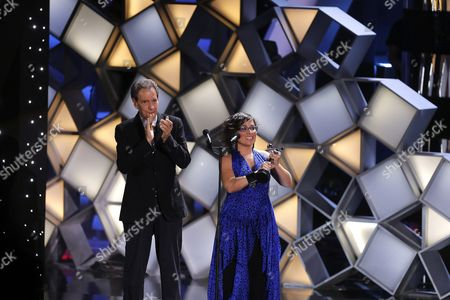 Stock Photo of Venezuelan Claudia Pinto (r) Receives the Award the Best First Film For Her Film ' La Distancia Mas Larga' (the Longest Distance) During the Platino Iberoamerican Film Awards Ceremony in Marbella Spain 18 July 2015 Spain Marbella(m?laga)