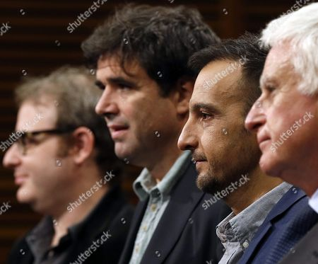 Stock Picture of Spanish Director Alejandro Amenabar (2-r) and Executive Producers Paolo Vasile (r) Fernando Bovaira (2-l) and Axel Kuschevatzky (l) Attend the Press Conference For 'Regression' at the 63rd Annual San Sebastian International Film Festival in San Sebastian Spain 18 September 2015 the Movie Presented in the Official Selection Opens the Festival Running From 18 to 26 September Spain San Sebastian