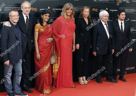 Stock Image of The Members of the Official Jury Danish Actress and President of the Jury Paprika Steen (c) Indian Actress Nandita Das (3-l) Spanish Film Director Daniel Monzon (l) Argentinian Producer Hernßn Musaluppi (r) French Producer Julie Salvador (3-r) Italian Film Director and Producer Uberto Pasolini (2l) and Italian Film Director Luciano Tovoli (2-r) Arrive at the 63th San Sebastian International Film Festival Opening Ceremony in San Sebastian Basque Country Spain 18 September 2015 the San Sebastian International Film Festival Will Run From 18 to 26 September 2016 Spain San Sebastian