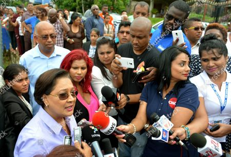 Trinidad and Tobago Prime Minister Kamla Persad-bissessar (l) Makes a Statement After Voting in General Elections at a Polling Station in Hermitage Village South Trinidad 07 September 2015 Persad-bissessar Leads the United National Congress and Its Three Coalition Partners Popularly Known As the 'People's Partnership' and is Seeking to Gain a Second Five-year Term in Office Trinidad and Tobago Trinidad