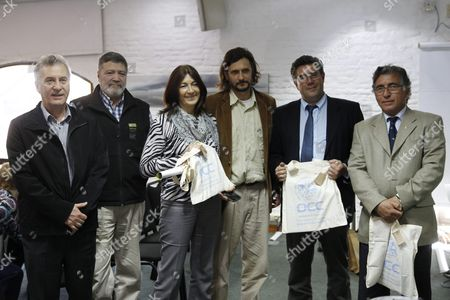 (l-r) Uruguayan National Director of Tourism Carlos Fagetti; Responsible of Biodiversity in the National Direction of Environment of Uruguay Mario Ballates; Uruguayan General Director of Ministery of Tourism Hyara Rodriguez; Exponent of Cetacean Conservation Organization (occ) Rodrigo Garcia; Deputy of the Florida (uruguay) Department Jose Arocena and the Deputy of Maldonado (uruguay) Department Dario Perez Pose During the Commemoration of the Appointment of Uruguayan Territorial Waters As a Sanctuary For Cetaceans Uruguay Want to Be an International Tourism Destiny Since There People Can See 50 to 70 Whales Mainly in Whale Season Between August and October Uruguay Montevideo