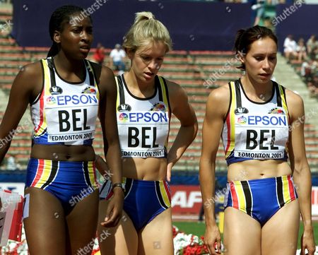 Edmonton Canada: (from Left) Belgians Elodie Ouedraogo Nancy Callaerts and Kim Gevaert Walk Off the Track After Setting with Team-mate Katleen De Caluwe (not Pictured) a New Belgian Record in Their Heat of the Womens 4x100m Relay at the 8th World Athletics Championships in Edmonton Saturday 11 August 2001