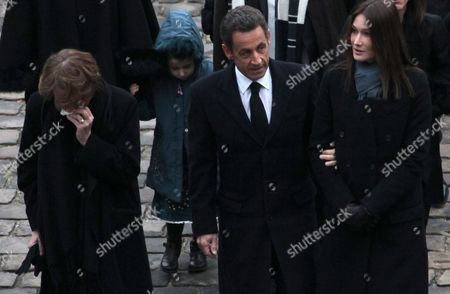French President Nicolas Sarkozy (c) and His Wife Carla-bruni Sarkozy (r) Walk with Beatrice Seguin (l) Widow of Philippe Seguin Former French Politician and President of the 'Cour Des Comptes' (france's Public Finance Watchdog Committee) During the Funeral Ceremony at Invalides in Paris France 11 January 2010 Seguin Died of a Heart Attack Aged 66 France Paris