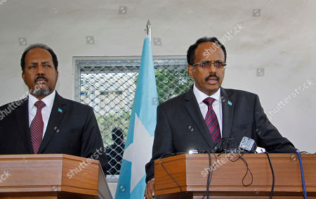 Mohamed Abdullahi Farmajo, Hassan Sheikh Mohamud Somalia's President Mohamed Abdullahi Farmajo, right, speaks at a handover ceremony with former president Hassan Sheikh Mohamud, left, at the presidential palace with in Mogadishu, Somalia . The Somalia-based extremist group al-Shabab is claiming responsibility for a mortar attack outside the presidential palace during a handover ceremony for the country's new president