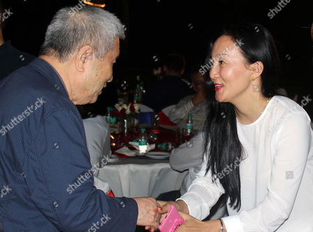 Stock Photo of South Korean Filmmaker Im Kwon-taek (l) Shakes Hands with Mongolian Actress Mungunzul Amgalanbaatar During Their Meeting at the Korea Day Event of the International Film Festival of India in Goa Southwestern India 21 November 2016 India Goa