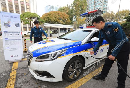 Two Police Officers Unveil a Plug-in Hybrid Electric Squad Car at a Police Station in Seoul South Korea 03 November 2016 the South Korean National Police Agency Stated That It Has Deployed Three Electric Cars For Patrol and Command Purposes Korea, Republic of Seoul