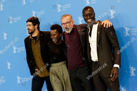 From left, actors Julio Machado, Isabel Zuaa, director Marcelo Gomes and actor Welket Bungue pose for the photographers during a photo call for the film 'Joaquim' at the 2017 Berlinale Film Festival in Berlin, Germany