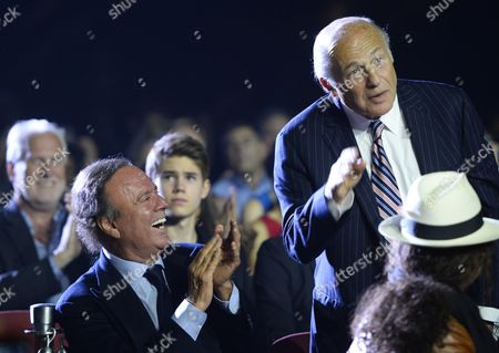 Singer Julio Iglesias (l) Applauds Music Producer Doug Morris (r) During a Break in the Berklee College of Music Pre-commencement Concert in Boston Massachusetts Usa 08 May 2015 Iglesias and Morris Are to Be Honored with a Degree From Berklee College of Music United States Boston