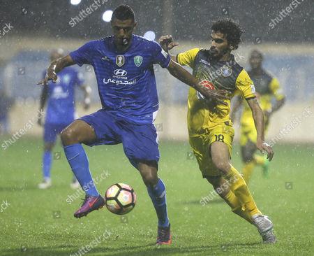 Al-Fateh player Riyadh Sharahili (L) in action for the ball with Al-Taawoun player Abdulaziz Al-Shared (R) during the Saudi Professional League soccer matchbetween Al-Fatehand Al-Taawounat Prince Abdullah bin Jalawi Stadium, Al-Hasa, Saudi Arabia, 16 February 2017.