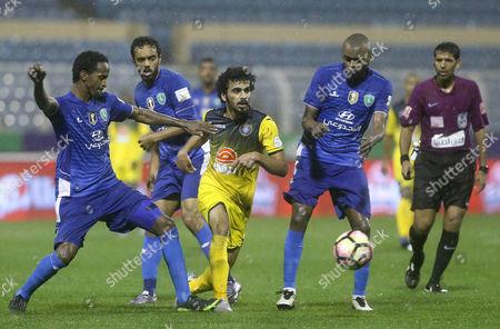 Al-Fateh player Sayaf Al-Bishi (L) in action for the ball with Al-Taawoun player Abdulaziz Al-Shared (R) during the Saudi Professional League soccer matchbetween Al-Fatehand Al-Taawounat Prince Abdullah bin Jalawi Stadium, Al-Hasa, Saudi Arabia, 16 February 2017.