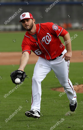 Washington Nationals relief pitcher Nick Lee runs through a drill during a spring training baseball workout, in West Palm Beach, Fla