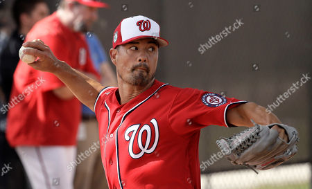 Washington Nationals Jeremy Guthrie throws during a spring training baseball workout, in West Palm Beach, Fla