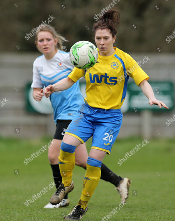 Sian Chapman of Torquay Ladies takes the ball on from Jamey Symons of Marine Academy Ladies during the Pat Sowden Trophy Semi Final match between Torquay United Ladies and Marine Academy Ladies, St Johns Lane, Bovey Tracey, Devon, England on Sunday 19th February, 2017 - Photo: Phil Mingo