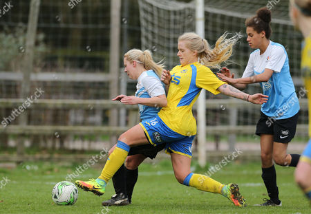 Chelsea Easton of Marine Academy Ladies defends from Jana-Kate Richards of Torquay Ladies during the Pat Sowden Trophy Semi Final match between Torquay United Ladies and Marine Academy Ladies, St Johns Lane, Bovey Tracey, Devon, England on Sunday 19th February, 2017 - Photo: Phil Mingo