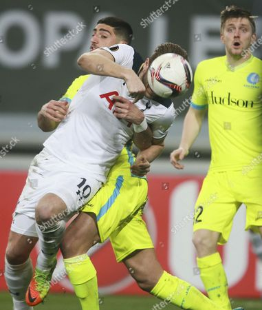 Tottenham Harry Kane (Frt) and Gent's   Samuel Gigot  fight for the ball during an UEFA Europa League soccer match between KAA Gent and Tottenham Hotspur FC  at the Ghelamco Arena, in Gent, Belgium, 16 February 2017.
