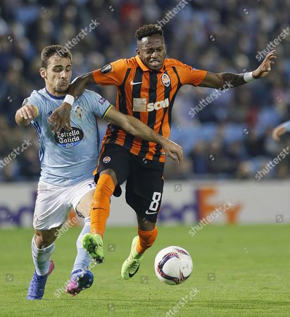 Stock Image of Celta de Vigo's defender Jonny Castro Otto (L) vies for the ball with Frederico Rodrigues de Paula Santos (R) from Shakhtar Donetsk's Taison Barcellos Freda (L) during the first leg match of the Europa League round of 16 between Celta de Vigo and Shakhtar Donetsk held at the Balaidos stadium in Vigo, Spain, on 16 February 2017.