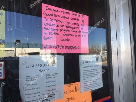 Stock Photo of A sign outside the Mexican candy store El Guero Loco in Albuquerque's South Valley, Albuquerque, N.M., announces that the store is closed in solidarity with a nationwide protest called A Day Without Immigrants. Immigrants around the U.S. stayed home from work and school Thursday to demonstrate how important they are to America's economy and its way of life, and many businesses closed in solidarity